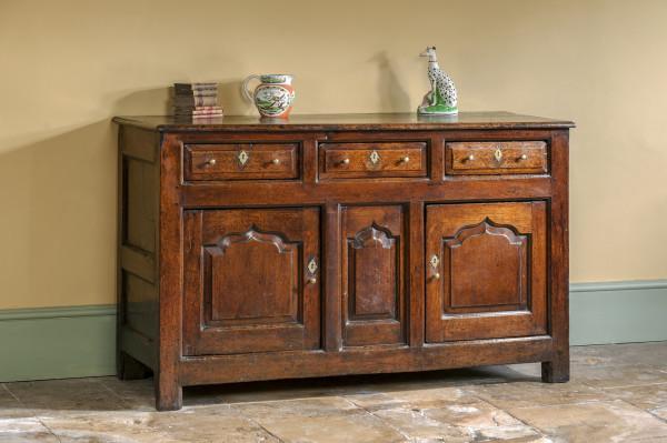 old english antique kitchen dresser base on flagstone floor